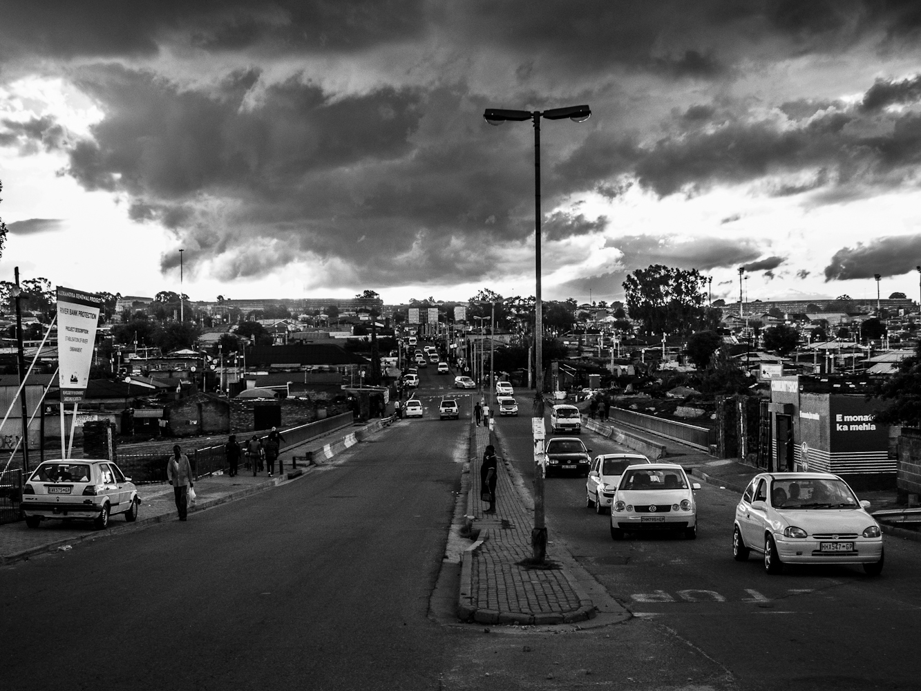 The main street of Alexandra township during sunset.